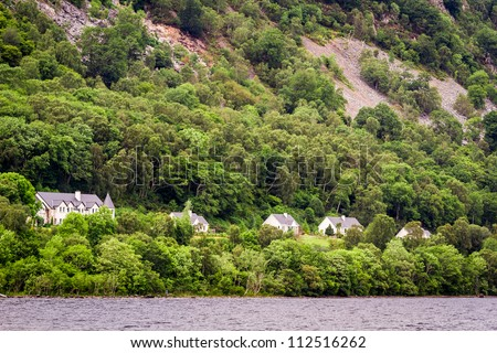 Houses on the cliff in the mountains - stock photo