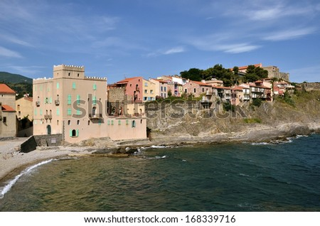 Houses on the cliffs of the coast of Collioure, commune on the cote vermeille in the Pyrenees-Orientales department, Languedoc-Roussillon region, in southern France. - stock photo