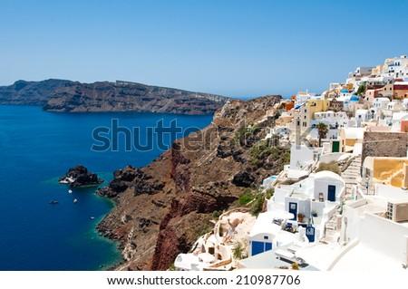 Houses on the edge of the caldera on the island of Santorini, Greece. - stock photo