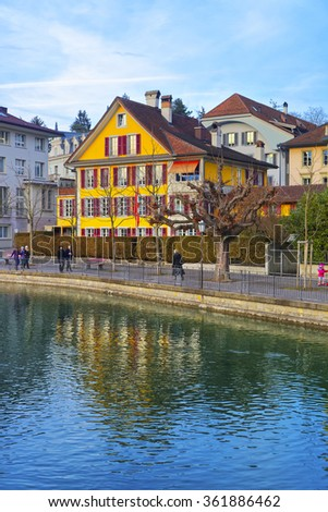 Houses on the Embankment in the Old City of Thun in Switzerland. Thun is a city in Swiss canton of Bern. It is located where Aare river flows out of Lake Thun.