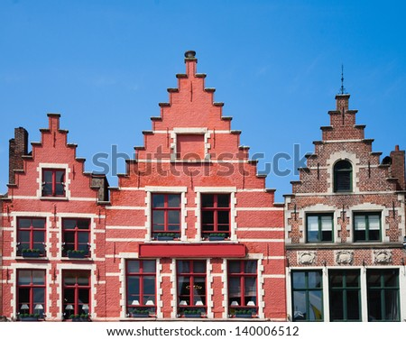 Houses on the market square in Brugge  - stock photo