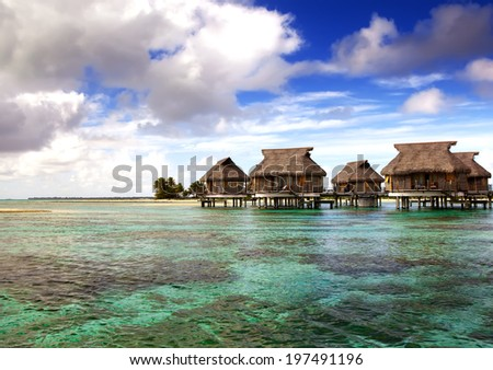 houses over the transparent quiet sea water