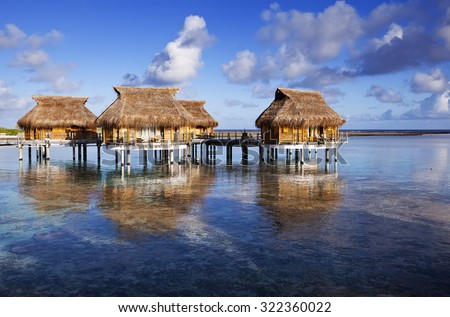 houses over the transparent quiet sea water - stock photo