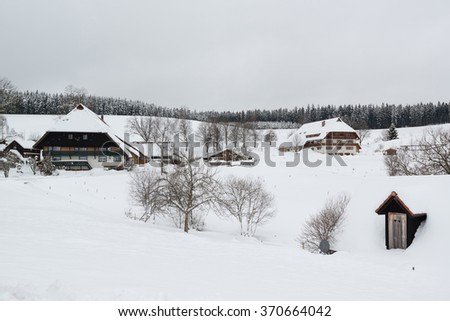 Houses typical for the black forest at the Brigachquelle (Brigach well) near St. Georgen in Germany  - stock photo