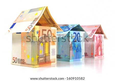 Houses with different Euro banknotes - stock photo