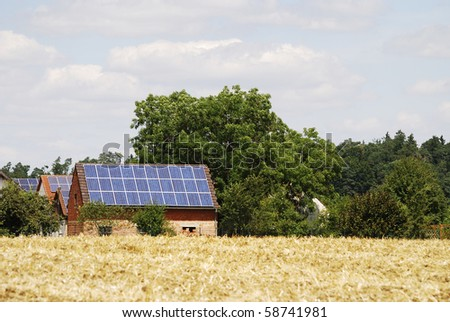 Houses with solar cells on the roof - stock photo