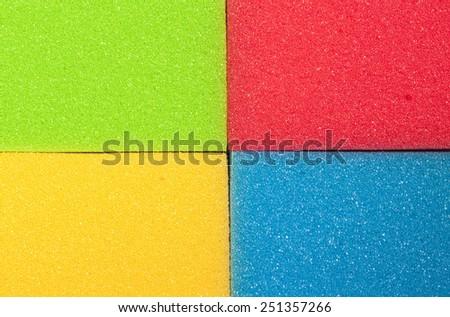 Houseware Concept. Closeup of Four Colorful Kitchen Sponges. Horizontal Image Composition - stock photo