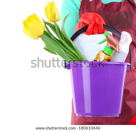 Housewife holding bucket with cleaning equipment. Conceptual photo of spring cleaning. Isolated on white - stock photo