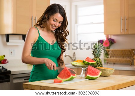 Housewife home in kitchen cutting board summer fruits nuts paleo diet weight loss healthy lifestyle - stock photo