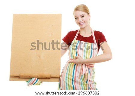 housewife in kitchen apron or small business owner with empty blank banner sign for restaurant menu recipe. Girl holding wooden board with copy space for text. Isolated on white - stock photo
