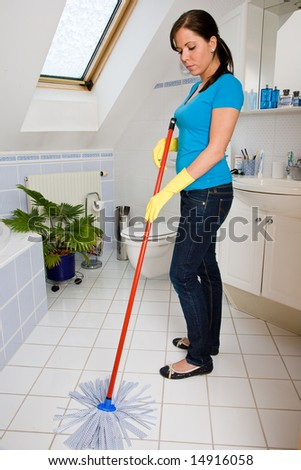 housewife is cleaning her flat - stock photo