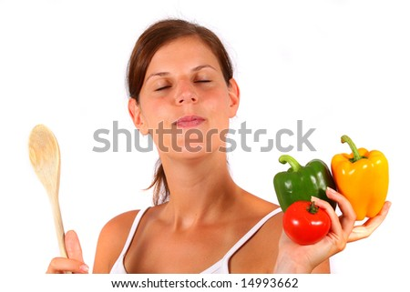 Housewife Is Dreaming A young woman with peppers and a spoon in her hands dreams. Ideal cooking / diet / housewife shot. - stock photo