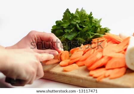 Housewife prepare healthy vegatable carrot to cooking - stock photo