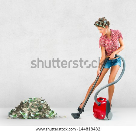 Housewife vacuuming - stock photo