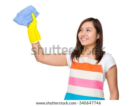 Housewife washing the imaginary wall