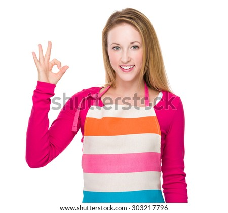 Housewife with ok sign gesture - stock photo