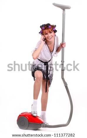 housewife with vacuum cleaner in hand - stock photo