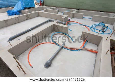 Housing construction site of Japan. Water and sewage pipes. - stock photo
