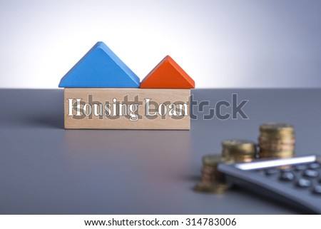 Housing Loan concept. House Wooden Block, coins and calculator with word Housing Loan  - stock photo