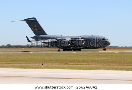HOUSTON - NOVEMBER 1: US AIr Force C-17 Globemaster jet arrives in Houston, Texas on November 1, 2009 for refueling. It is the most popular heavy lift jet of the USAF - stock photo