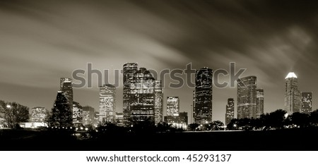 Houston Skyline at night with beautifully lighted clouds in Monochrome - stock photo