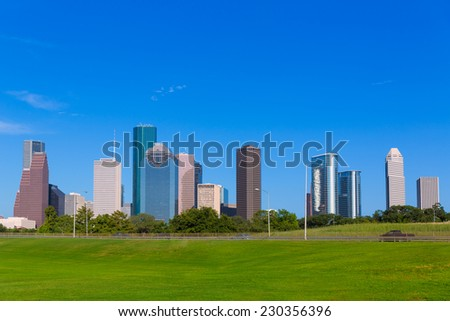 Houston skyline blue sky and Memorial park turf at Texas USA US - stock photo