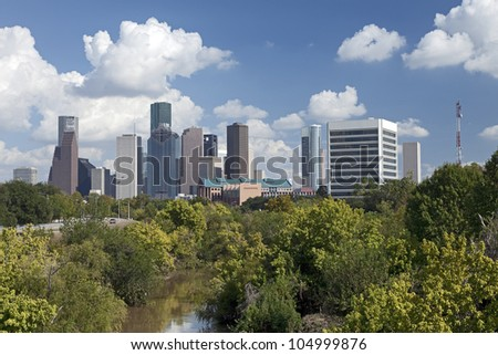Houston Skyline with a Park and a River in the Foreground. - stock photo