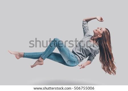 stock photo hovering in air full length studio shot of attractive young woman hovering in air and smiling 506755006 woman levitating stock images, royalty free images & vectors Wire Harness Assembly at soozxer.org