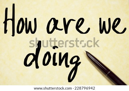 how are we doing text write on paper  - stock photo