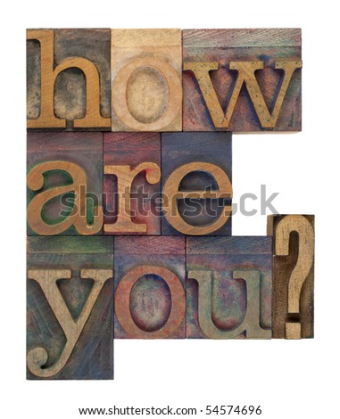 how are you question in vintage wooden letterpress type blocks, stained by color ink, isolated on white