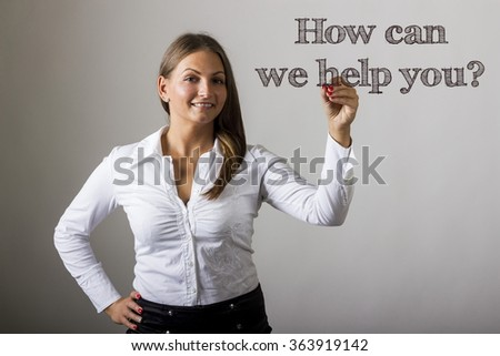 How can we help you? - Beautiful girl writing on transparent surface - horizontal image
