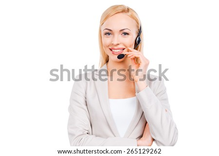 How may I help you? Confident mature customer service representative adjusting her headset and smiling while standing against white background - stock photo