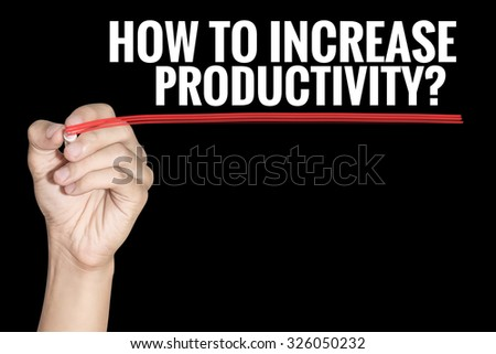 How To Increase Productivity word writting by men hand holding highlighter pen with line on black background - stock photo