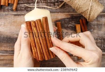 How to make candle decorated with cinnamon sticks - step by step, tutorial - stock photo