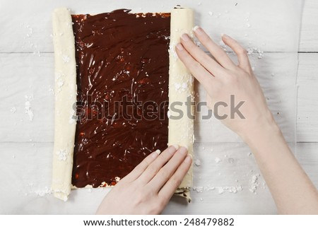 How to make palmier biscuits - french cookies made of puff pastry and chocolate (also called palm leaves, elephant ears, french hearts, shoe-soles or glasses). Step by step, tutorial - stock photo
