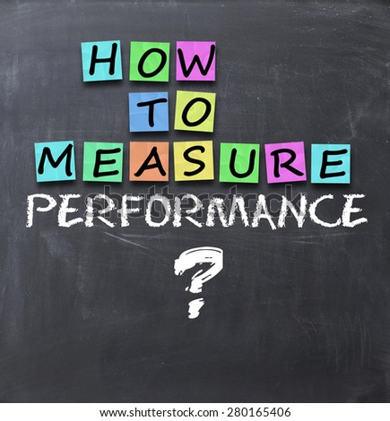 How to measure performance text on blackboard - stock photo