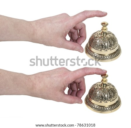 How to ring for service shown by a hand tapping on a brass intricate service bell placed on a counter - Path included - stock photo