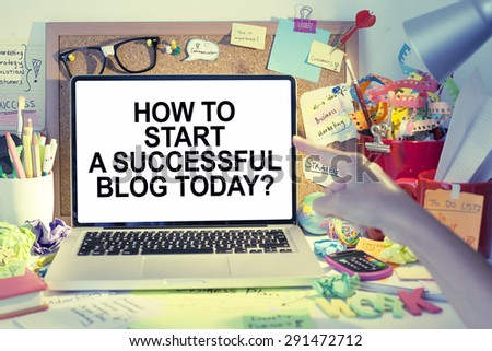 How to start a successful blog today note on laptop - stock photo