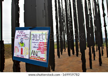 Howick, KwaZulu-Natal, South Africa - 15 December 2013: A message to the recently deceased Nelson Mandela stuck on the monument at the site where the former political activist was captured in 1962. - stock photo