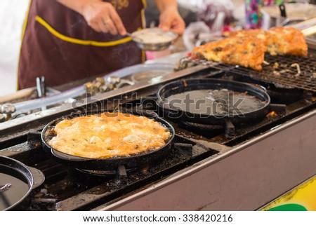 Hoy Tod ; Crispy oyster omelet on Thai street food market - stock photo