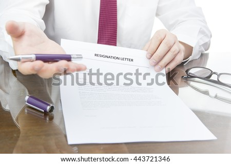 HR manager want to fired an employee then he giving a resignation letter to the employee, getting fired concept. - stock photo