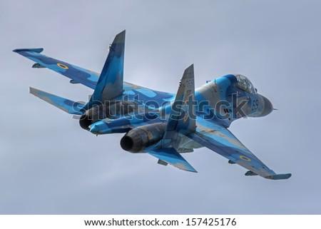 HRADEC KRALOVE, CZECH REPUBLIC - SEPTEMBER 8: Ukrainian Air Force Su-27UB during 20th Czech International Air Fest September air show - September 8, 2013 in Hradec Kralove, Czech republic - stock photo