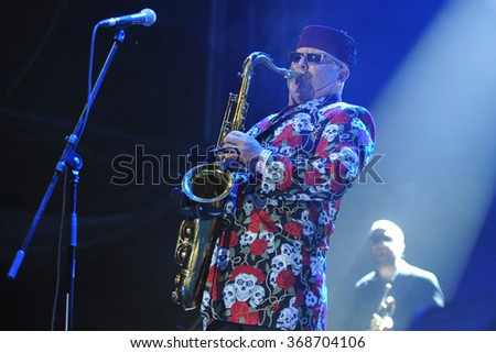 HRADEC KRALOVE - JULY 4: British saxophonist Lee Thompson of the band Madness performs during the music festival Rock for People in Hradec Kralove, Czech Republic, July 4, 2014