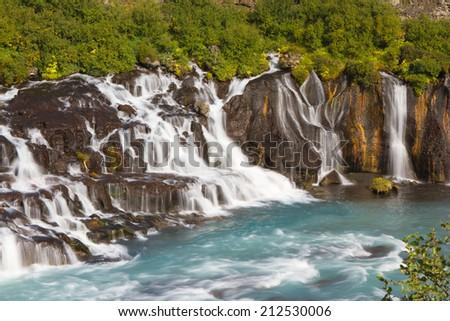 Hraunfossar, a series of waterfalls in western Iceland - stock photo