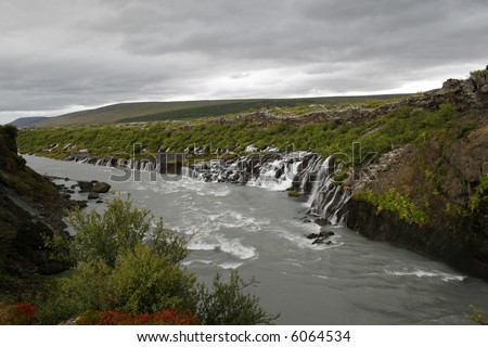 Hraunfossar, Borgarfjordur, Iceland. Underground river ends through lava as a waterfall into a wild river. - stock photo