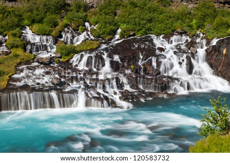 Hraunfossar is a very beautiful Icelandic waterfall in the west of the island. - stock photo