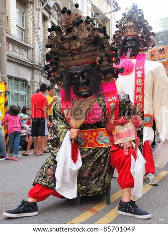HSINCHU, TAIWAN-AUGUST 14:The puppets of Seventh Lord and Eighth Lord in a Chinese Ghost Festival parade in Hsinchu, Taiwan on August 14, 2011. 7th Lord and 8th Lord are the generals of the City God. - stock photo