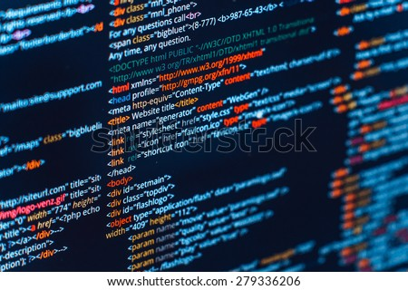 HTML and CSS code developing screenshot. Abstract web site source listing on black background with colored syntax - stock photo