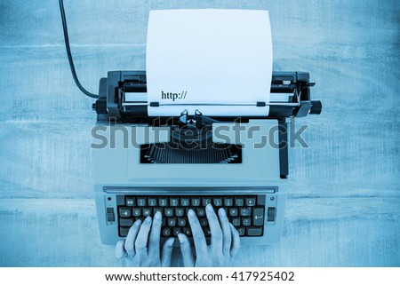 http written against white background against above view of old typewriter