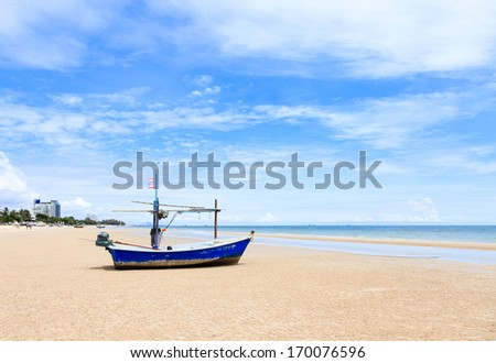 Hua Hin beach with traditional fishing boat - stock photo